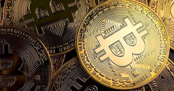image-close-up-of-golden-coins-with-bitcoin-symbol-background